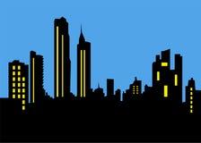 在夜背景的都市城市地平线 免版税库存照片