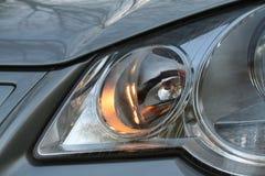 在大众波罗IV的车灯 免版税库存图片