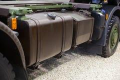 在大军用卡车的汽油箱 免版税库存照片