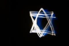 在大卫王之星的形状的抽象光带 图库摄影