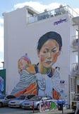 在大厦墙壁上的街道画  图库摄影