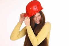 在大厦盔甲的女孩可笑的建造者 图库摄影