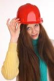 在大厦盔甲的女孩可笑的建造者 免版税图库摄影