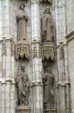在大教堂的墙壁上的四个雕象在塞维利亚 图库摄影