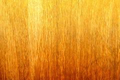 在大木片断的梯度橙色木条纹篱芭 图库摄影