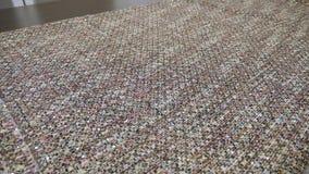 在大桌的裁缝投掷的织品在慢动作宽射击 影视素材