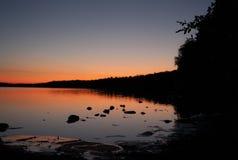在大湖的日落 免版税库存照片