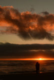 在大炮海滩的日落,在中央俄勒冈海岸 图库摄影