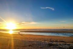 在大炮海滩的日落 图库摄影