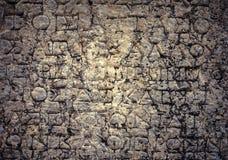 在大理石背景的古老字母表 免版税图库摄影