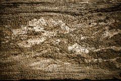 在大理石背景的古老字母表 图库摄影