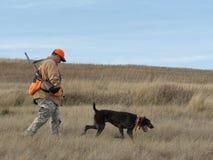 在大草原的猎人 库存图片