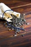 在大袋的向日葵种子在木背景 免版税库存照片