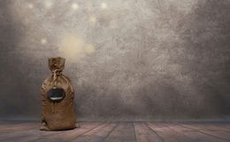 在大袋的形状的Moneybox 图库摄影