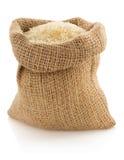 在大袋袋子的米在白色 免版税图库摄影