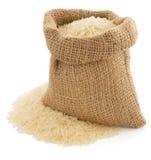 在大袋袋子的米在白色 免版税库存照片