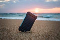 在大西洋附近的便携式的小太阳电池板 免版税库存图片