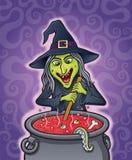 在大锅的邪恶的巫婆酿造咒语 库存照片