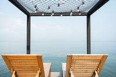 在大阳台的两张海滩睡椅 免版税图库摄影