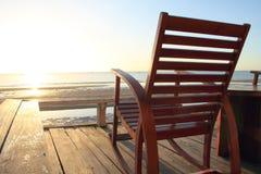 在大阳台的摇椅,日出 免版税库存照片