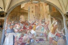 在天主教徒和异端者之间的争斗在圣皮特圣徒・彼得时受难者,壁画在圣玛丽亚中篇小说教会,佛罗伦萨里 免版税库存照片