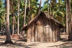 在天堂海滩的秸杆小屋 库存照片