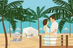 在天堂海滩胜地的夫妇 免版税库存照片