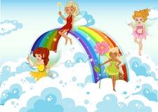在天空上的神仙在彩虹附近 免版税库存图片