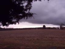 在天空的云彩盖帽 图库摄影