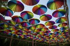 在天空的五颜六色的伞 库存图片