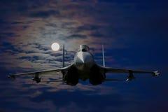 在天空的俄国军用飞机 免版税库存照片