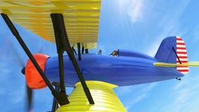 在天空的双翼飞机飞行 库存例证