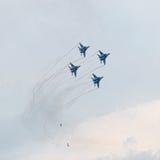 在天空的四架军用喷气机 免版税库存照片