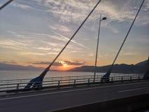 在天空的火 Rion - Antirion桥梁,希腊 库存图片