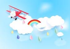 在天空的纸艺术样式飞机飞行与云彩和多雨 库存照片
