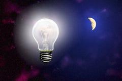 在天空的背景的光亮光与月亮的 免版税库存图片