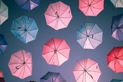 在天空背景的色的开放伞 免版税库存图片