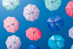 在天空背景的色的开放伞 图库摄影
