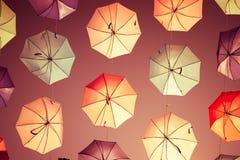 在天空背景的色的开放伞 库存照片
