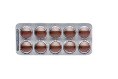 在天线罩包装的棕色药片 库存照片