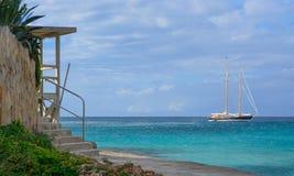 在天蓝色的海的风船 库存照片