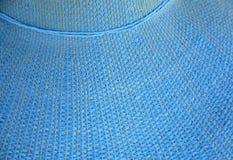 在太阳帽子的蓝色样式 免版税库存图片