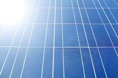 在太阳电池板的阳光 免版税库存图片