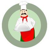 一个盖帽的厨师有盘子的 库存图片
