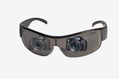 在太阳镜透镜反映的照相机 免版税库存图片