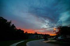 在太阳集合的红色云彩 图库摄影