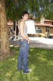 """在套的Talan Torriero佩带的标记牛仔裤""""资深跳天"""" 免版税库存照片"""