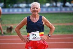 在奥林匹克的前辈的赛跑者 免版税库存照片