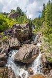 在女低音阿迪杰山的瀑布 免版税图库摄影