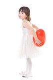 在女孩之后的回到气球红色她的一点 免版税库存照片